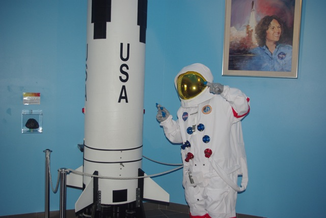 Apollo Astronaut with Saturn V