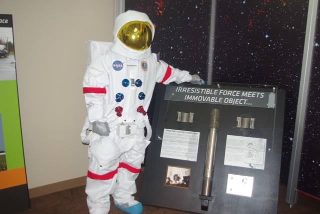 Apollo Astronaut checks out shuttle nuts & bolts at MSDC