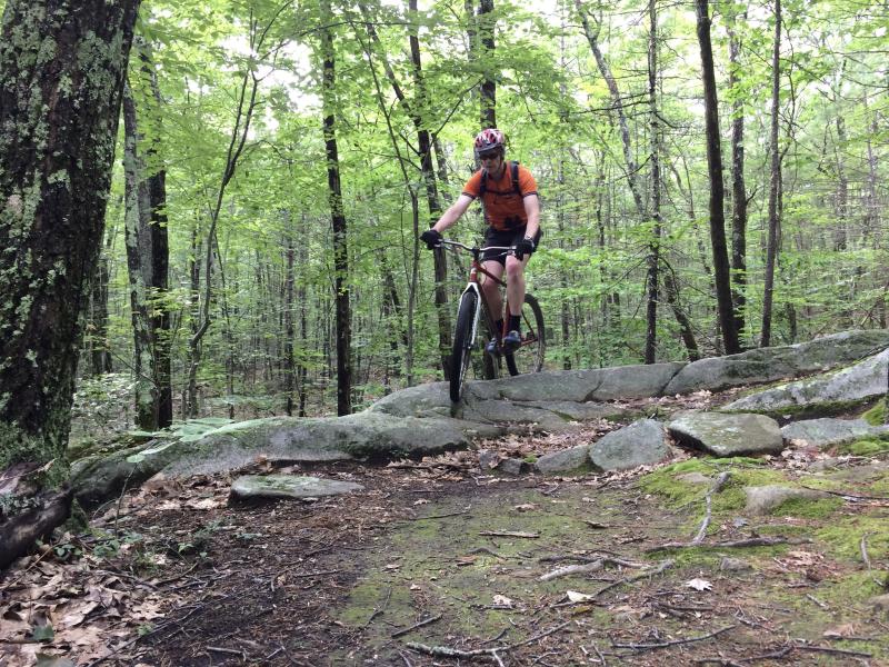 Photo of Jim Jensen mtn biking by Jim owers